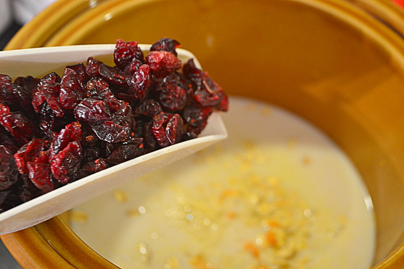 Dried cranberries in a white spoon