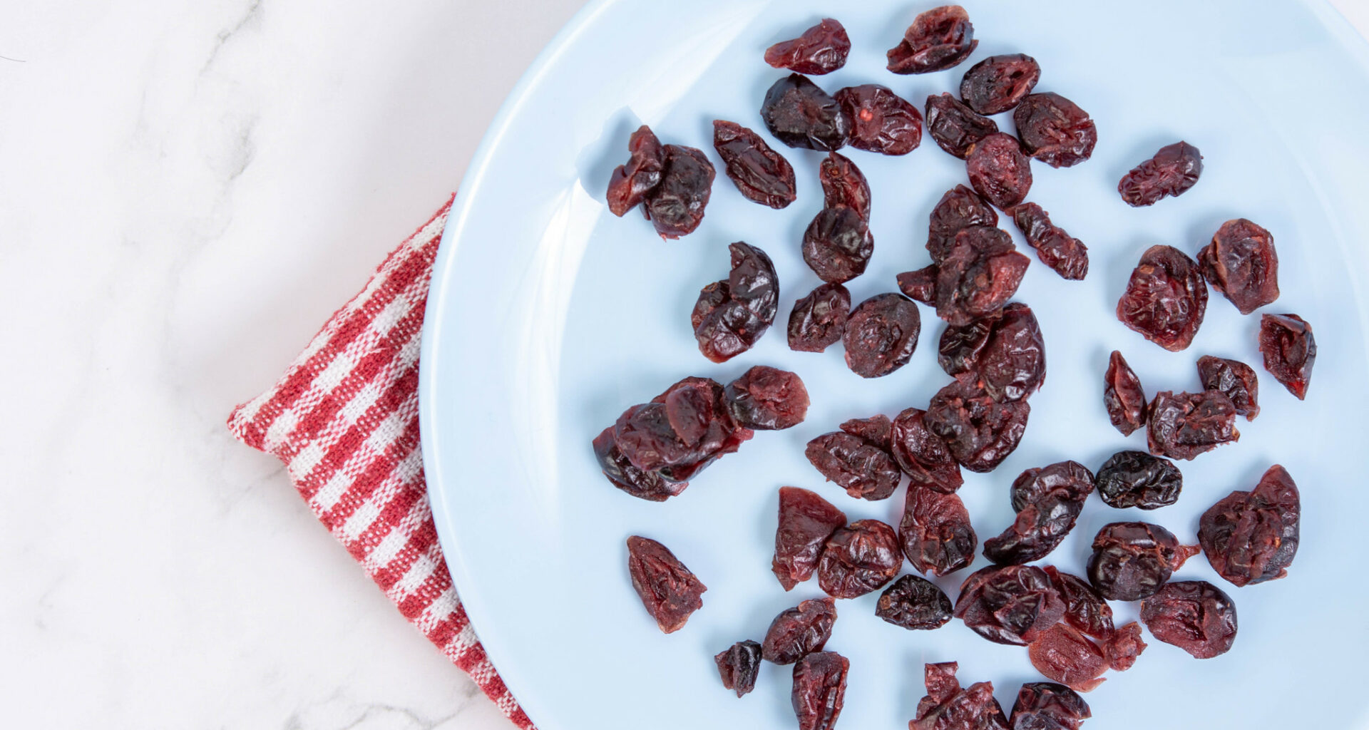 Dried Cranberries on a White Plate